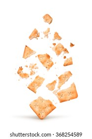 the explosion of the cracker into pieces isolated on white background