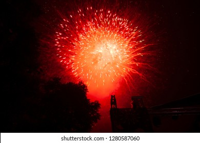 Explosion of fireworks in red celebrating the new year in Mexico City
