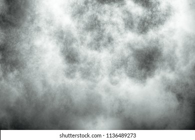 Explosion of grey powder, smoke background.