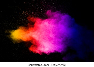 Explosion of multicolored dust on black background.