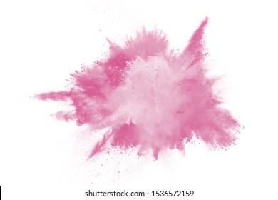 Explosion of pink colored powder isolated on white background.Pink dust splash.