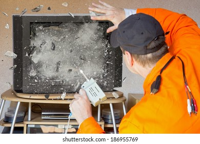 Explosion of TV. The TV screen explodes. Repairing televisions explosion. TV repairman cause an explosion. Television Service. Accident during repair television. The television screen explodes,