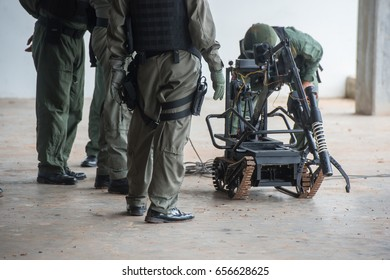 Explosive Ordnance Disposal Officers with Robot