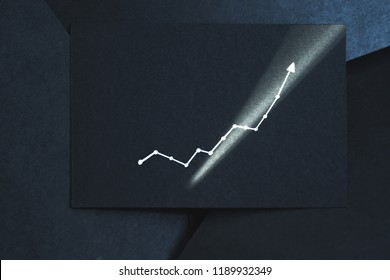 exponential graph. growth breakthrough success concept. arrow pointing upward on black paper.