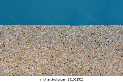 exposed aggregate finish edge of swimming pool