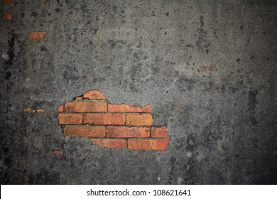 Exposed brick on a damaged wall