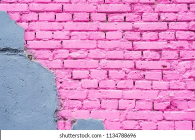 Exposed brick on damaged wall, abstract background from concrete and painted pink brick wall texture urban background, copy space
