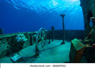 The exposed bridge and helm of the USS Kittiwake in Grand Cayman. The sunken shipwreck has a wheel still in place for scuba divers to play with when exploring this popular attraction