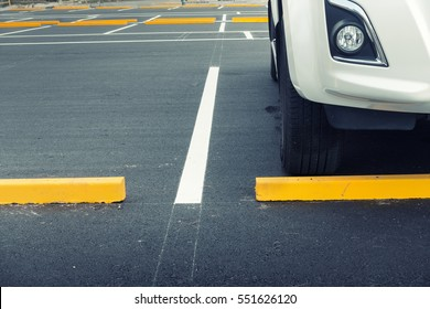 Exposed car parking and straight line background.
