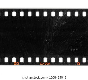 Exposed film material, long 35mm dia film strip on white, film texture with signs of usage and dust, real photo or celluloid scan