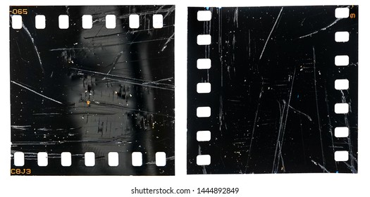 exposed film material type 35mm or 135, black and empty filmstrip with scratches, cellotape and light effects, grungy filmstrip macro photo