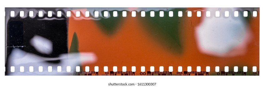 exposed negative film strip template with real light leaks, developed 135 type material (35mm) isolated on white background, blank grained film texture.