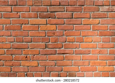 exposed red brick wall texture as background, close up, horizontal