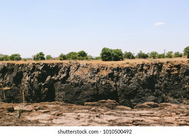 Exposed rock formation on the Zambia side of the Victoria Falls, a waterfall in southern Africa on the Zambezi River, at the end of the dry season.