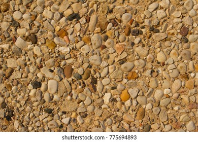 Exposed Stone Wall Background with varying sized and shaped natural aggregate in sand grout