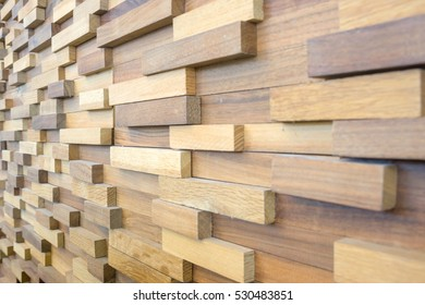 exposed wooden wall exterior, patchwork of raw wood forming a beautiful parquet wood pattern.(selected focus)