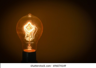 Exposed yellow filament light bulb.