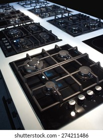 Exposition of many modern gas stoves for kitchen. Diagonal view closeup