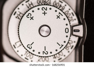 Exposure compensation and ISO dial on a old style single lens reflex SLR camera