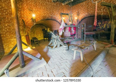 Exposure excruciation tools from the inside in the museum room with red brick walls. Torture room, Artillery Yard Complex, Astrakhan Kremlin, Russia - September 2014.