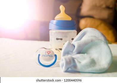 expresed milk 5 days after mother delivered baby, colostrum changing to a milk, breastfeeding concept