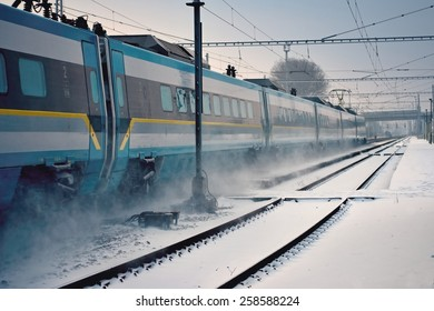 Express train passing through snowy station