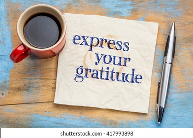 Express your gratitude - handwriting on a napkin with a cup of coffee
