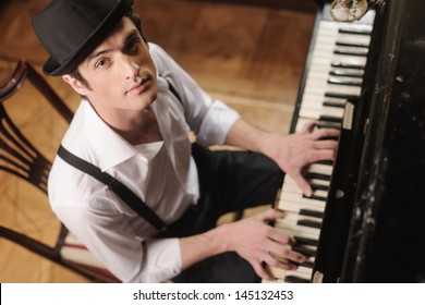 Expressing myself with music. Top view of handsome young men playing piano and looking at camera