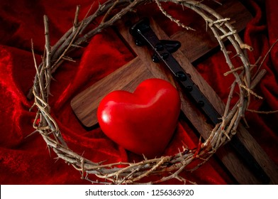 The expression of absolute love through the self sacrifice of Jesus Christ for the absolution of the original sin, christian holiday of Easter and Christianity concept with a heart and bleeding cross