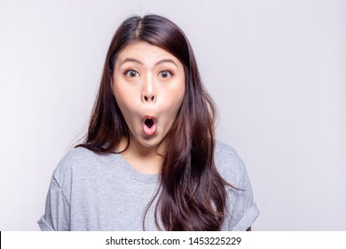 Expression concept. Beautiful asian woman says wow and gets shocked, surprised or wonder when pretty girl see something, product that she like or love. She has long hair. copy space, white background