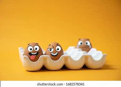 The expression and expression of the egg in the egg tray on a yellow background