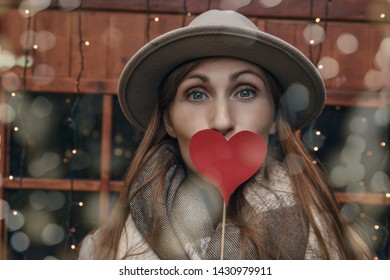 expression face holding heart giving kiss