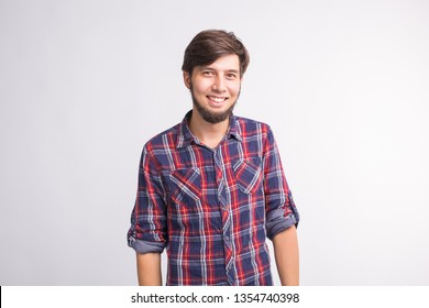 Expression and gesture concept - Handsome man laughing over white background