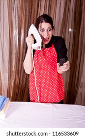 expression of housewife with cell phone and iron