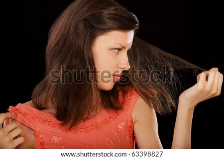 expression portrait of beautiful girl touching her weak hair and looking sad