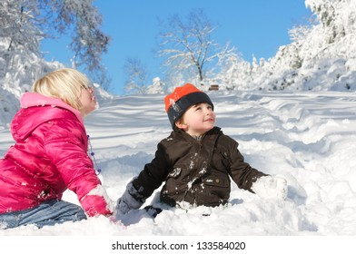 An expression of wonder and innocence as children play in a freshly fallen snow.