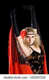 Expressive beautiful young girl dancing classical spanish dance.
