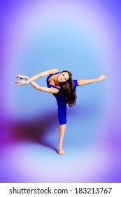 Expressive bellet dancer dancing at studio.