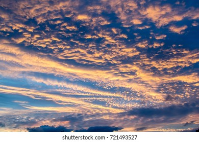 Expressive cloud scape with vibrant colors on the sky during dusk