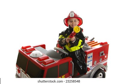 Expressive cute toddler with fireman's outfit on a fire truck
