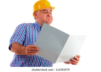 expressive engineer looking at plans isolated on white