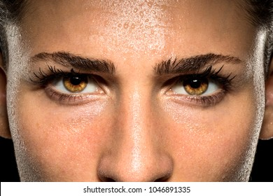 Expressive female eyes during fitness exercise workout showing endurance, stamina, confidence, and power