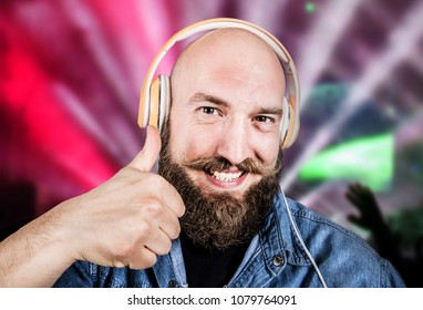 expressive man listen music with headphone