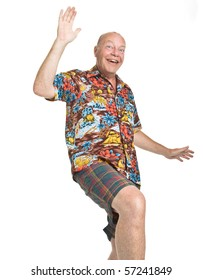 Expressive old man in loud shirt holiday concept isolated against white.