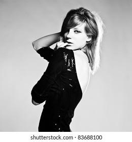 Expressive studio shot of young beautiful woman