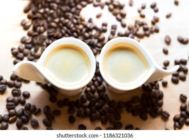 Expresso - two cups and coffee beans