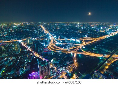 Expressway intersection road at night in Bangkok city , landscape Thailand
