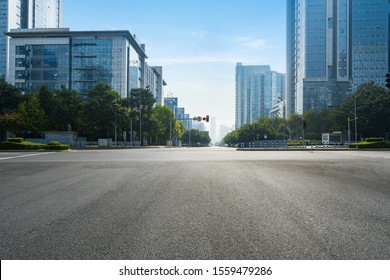The expressway and the modern city skyline are in Chongqing, China. - Shutterstock ID 1559479286