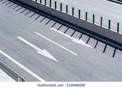 expressway pavement and traffic arrow closeup