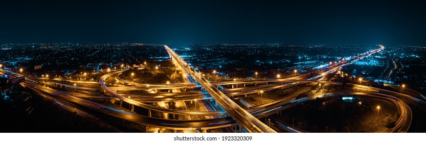 Expressway top view, Road traffic an important infrastructure in Thailand. Road and Roundabout, multilevel junction motorway, Panorama Aerial view